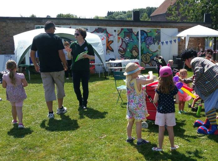 Jarvis Brook Community Fun Day 2015 - member of Groudworks talking to members of the public
