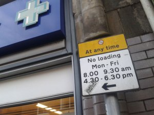 No Loading sign outside Boots on the High Street in Crowborough