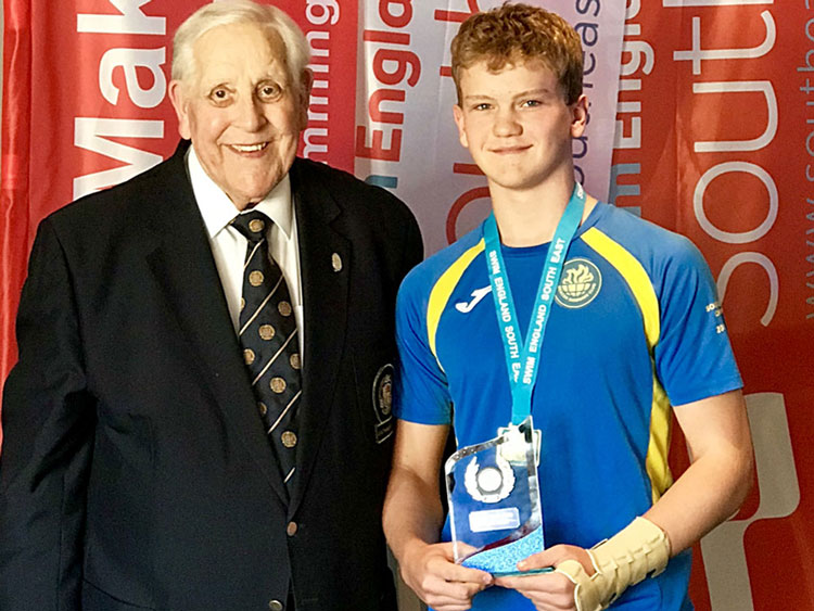 Henry being awarded Swim England South East Region Youth Volunteer of the Year award on  Sunday 15th September by Ray Hedger Past President of the Amateur Swimming Association.