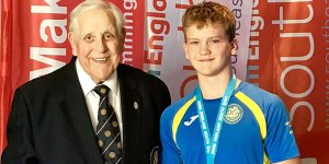 enry being awarded Swim England South East Region Youth Volunteer of the Year award on Sunday 15th September by Ray Hedger Past President of the Amateur Swimming Association.