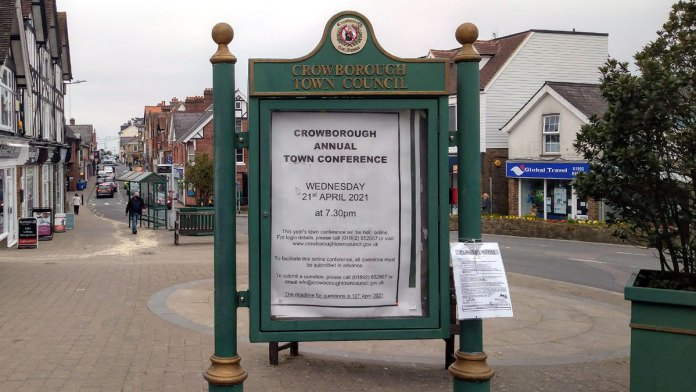 "Poster Board at The Broadway in Crowborough.  Displaying poster ""Crowborough Annual Town Conference Wednesday 21st April 202021 at 7.30pm)"