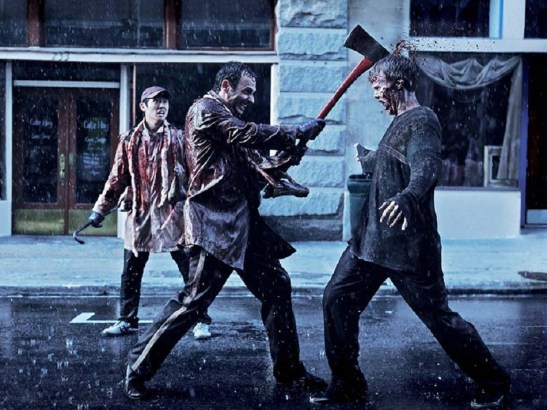man killing zombie with an ax
