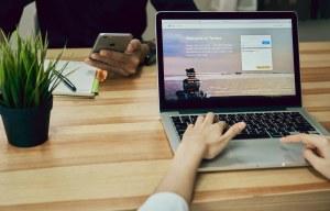 Women using Laptop open Twitter application