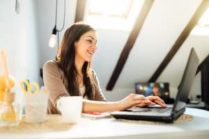 Business Woman Working From Home On Laptop Computer.checking Ema