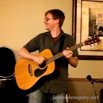 Jonathan Penn playing acoustic guitar