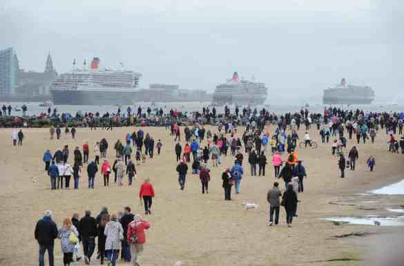 The Three Queens on the River Mersey as part of Cunard's 175th Anniversary celebrations in Liverpool. Thousands of spectators on the beach at New Brighton,Wirral,watching the Three Queens head up the Mersey.