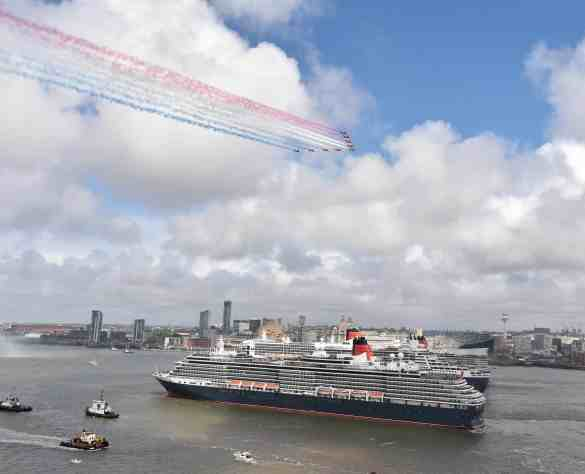 The Red Arrow's fly past Queen Elizabeth, Queen Victoria and Queen Mary in the river Mersey  to celebrate the 175th anniversary of Cunard