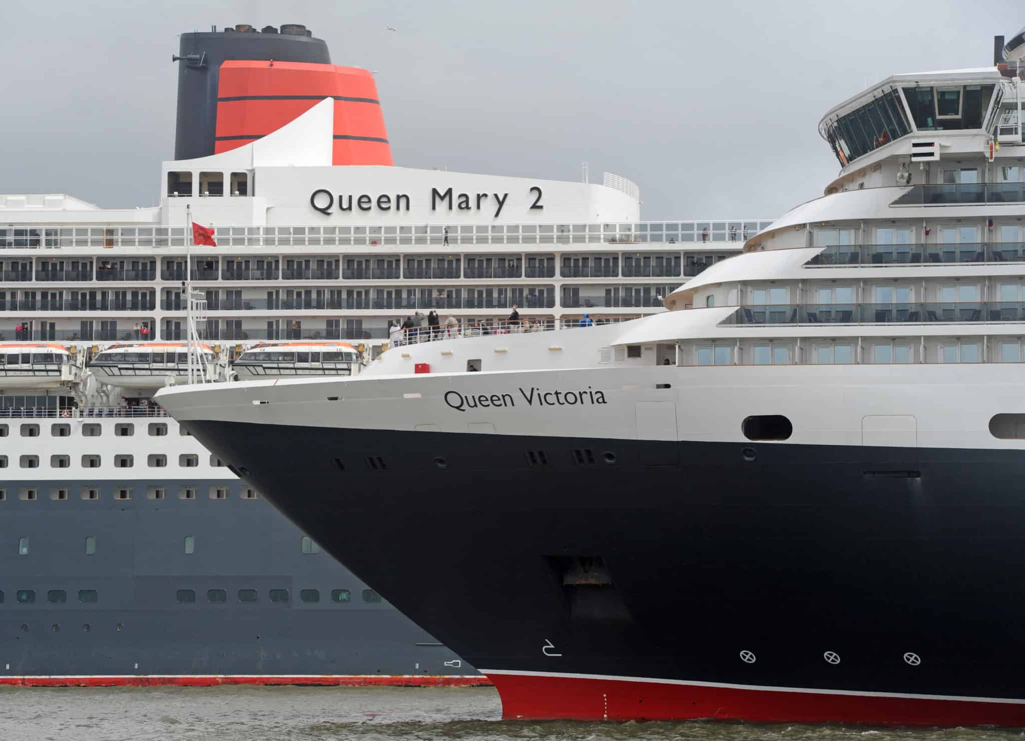 Cunard 175th celebrations on the River Mersey, Liverpool pictured The Three Queens cruise liners Queen Mary 2 and Queen Victoria on the river. Photo by Colin Lane