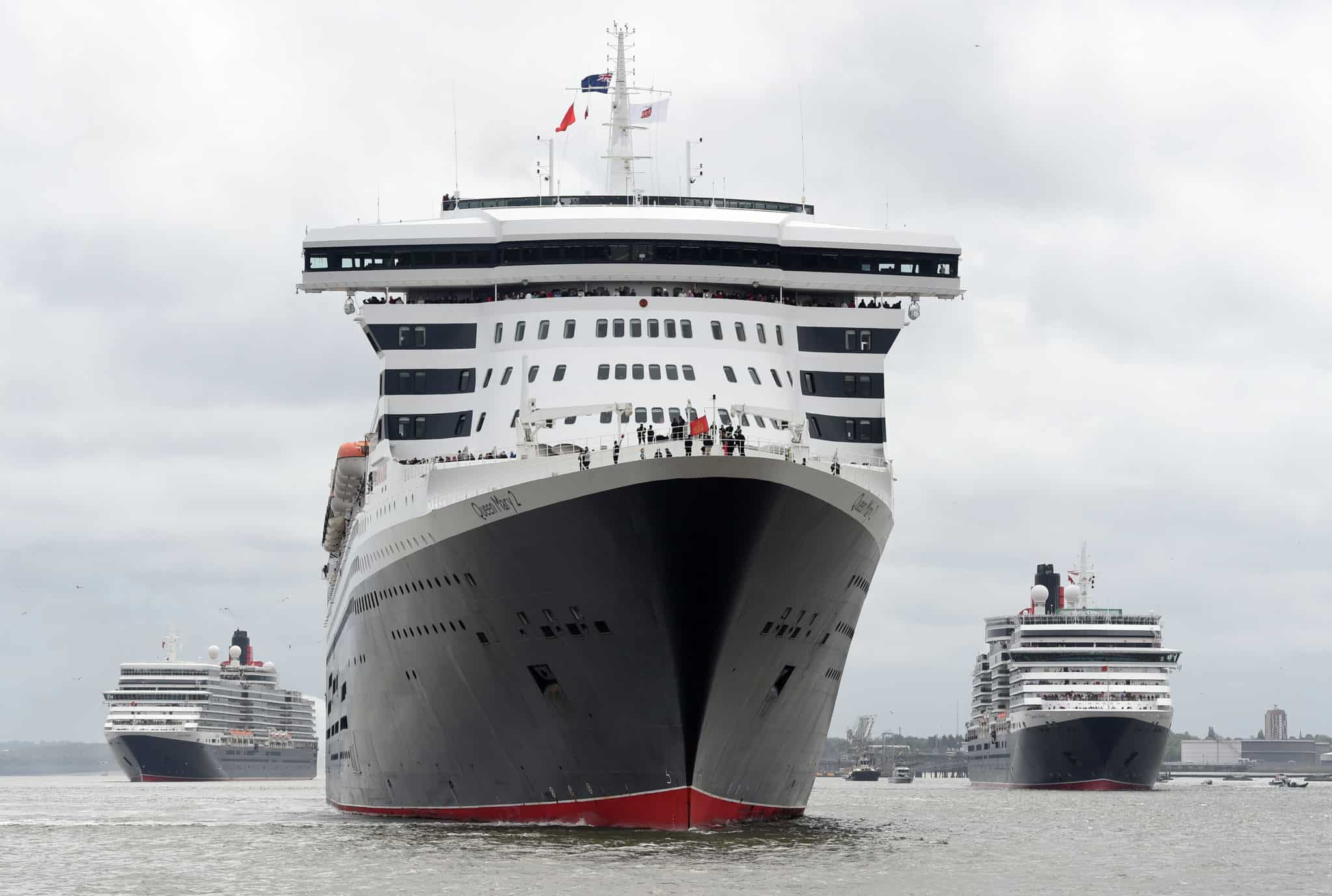 Cunard 175th celebrations on the River Mersey, Liverpool pictured The Three Queens cruise liners Queen Mary 2, Queen Elizabeth, Queen Victoria on the river. Photo by Colin Lane