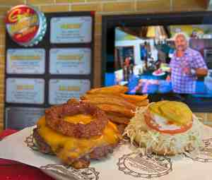 Guests aboard Carnival Vista can enjoy burgers at Guy's Burger Joint with cooked-to-order hamburgers and French fries inspired by Food Network star Guy Fieri. The largest and most innovative cruise vessel in Carnival Cruise Line's fleet, Carnival Vista measures 133,500 tons, 1,055 feet long and has a guest capacity of almost 4,000 passengers. Photo by Andy Newman/Carnival Cruise Line