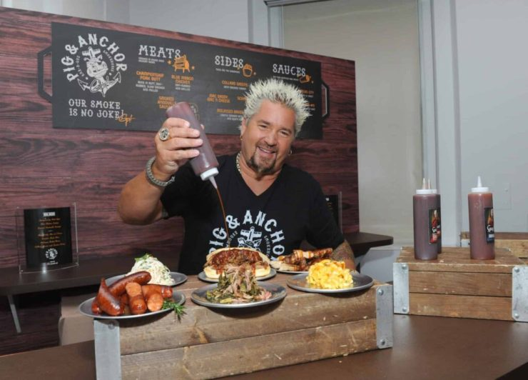 Food Network Star Guy Fieri serves up food from his new Pig & Anchor Bar-B-Que Smokehouse, exclusively on Carnival Cruise Line, at CarnivalÕs Summertime Beer-B-Que, Wednesday, July 27, 2016, in New York. (Diane Bondareff/ AP Images for Carnival Cruise Line)
