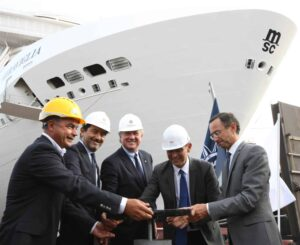 1. MSC Cruises executives, Mr Pierfrancesco Vago and Mr Gianni Onorato, open the valve with STX Director