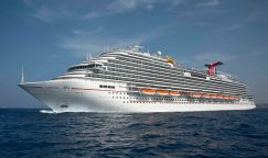 The Carnival Vista cruises at sea. The largest and most innovative cruise vessel in Carnival Cruise Line's fleet, Carnival Vista measures 133,500 tons, 1,055 feet long and has a guest capacity of almost 4,000 passengers. Photo by Andy Newman/Carnival Cruise Line