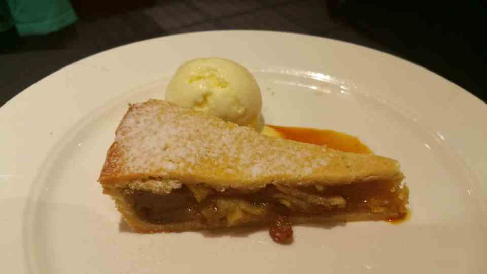 Warm Apple Pie, Served with Ice Cream and Carmel Sauce.