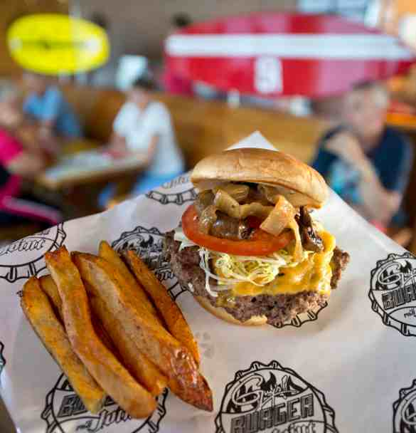 One of the many dining options aboard Carnival Sunshine is GuyÕs Burger Joint, a free casual poolside venue developed in tandem with Food Network star Guy Fieri and serving handcrafted burgers and fresh-cut fries. (Andy Newman/Carnival Cruise Lines)