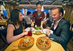 Guests aboard the Carnival Sunshine are served Far East cuisine at the Ji Ji Asian Kitchen. Photo by Andy Newman/Carnival Cruise Lines