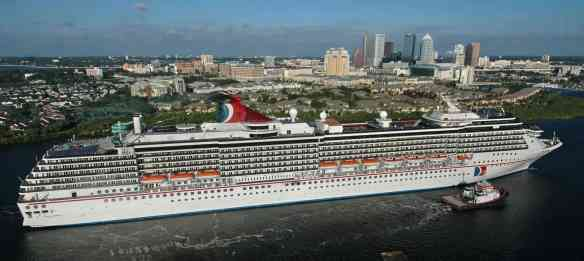 The 2,124-passenger Carnival Miracle arrives in Tampa, Friday, Nov. 5, 2004, to begin year-round, seven-day western Caribbean cruises from that port on Sunday, Nov. 7. At 960 feet in length, Miracle is the largest passenger vessel ever to base in Tampa, according to Tampa Port Authority officials. Completed in early 2004, the vessel offers a wide variety of amenities and features, including a 14,500-square-foot health club, promenades, a childrenÕs play room, wedding chapel and an Internet cafe. (Photo by Andy Newman/HO/Carnival Cruise Lines)