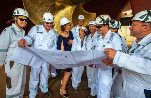 Sissel Kyrkjebø, Godmother for the Viking Jupiter, with construction workers during the Float Out Ceremony at the Fincantieri Shipyard, Ancona, Italy.