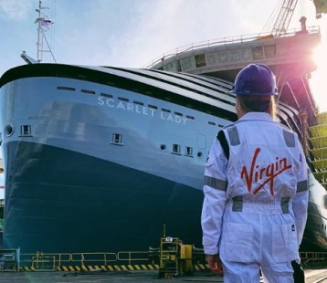 scarlet lady, virgin voyages' first ship, was recently floated out in genoa