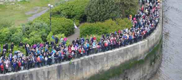 Crowds at Woodside to see the Queen Elizabeth, Queen Victoria and Queen Mary in the river Mersey  to celebrate the 175th anniversary of Cunard