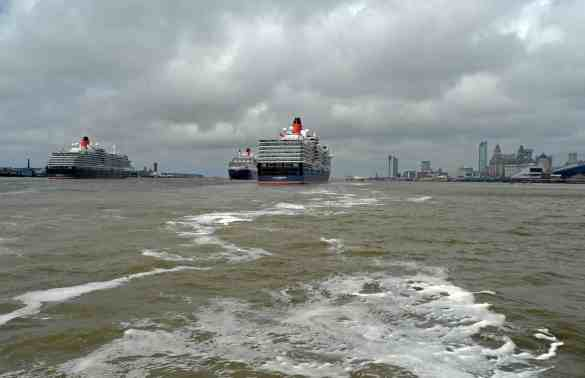 Cunard 175th celebrations on the River Mersey, Liverpool pictured The Three Queens cruise liners Queen Victoria, Queen Mary 2 and Queen Elizabeth on the river. Photo by Colin Lane