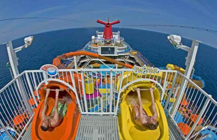 The WaterWorks aqua park on Carnival Two guests on the Carnival Magic a main feature of the ship's WaterWorks aqua park, a 312-foot-long Twister waterslide (entrance on right), and the DrainPipe slide attraction (left). The Twister slide is the longest side in Carnival's fleet. Photo by Andy Newman/Carnival Cruise Lines