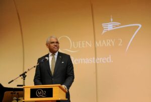 Arnold Donald, CEO, Carnival Corporation, the parent company of Cunard, speaks about the remastered Queen Mary 2, Wednesday, July 6, 2016, at Brooklyn Cruise Terminal in New York, its U.S. homeport.  The Queen Mary 2 spent 25 days in dry dock and a refit that cost in the region of $132 million, renovating its staterooms, restaurants and public areas.  (Diane Bondareff/AP Images for Cunard)