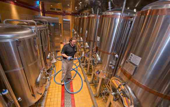 Carnival Vista Brewmaster Colin Presby tends to fermentation tanks in the RedFrog Pub onboard Carnival Vista. The largest and most innovative cruise vessel in Carnival Cruise Line's fleet, Carnival Vista measures 133,500 tons, 1,055 feet long and has a guest capacity of almost 4,000 passengers. Photo by Andy Newman/Carnival Cruise Line