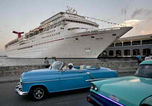 Vintage cars pass the Carnival Paradise while the cruise ship is docked in Havana, Cuba. (Andy Newman/Carnival Cruise Line)