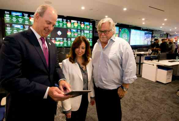 At the formal preview of Carnival Cruise Line's new Fleet Operations Center, from left are William Burke, chief maritime officer for Carnival Corp.; Christine Duffy, Carnival Cruise Line president; and Micky Arison, Carnival Corp. chairman; Thursday, May 10, 2018, at the company's Miami headquarters. Featuring a 74-foot-long video wall composed of 57 LED screens, the 35,000-square-foot facility is custom-designed for hands-on, around-the-clock monitoring and support of the line's 26 cruise ships. (Andy Newman/Carnival Cruise Line)
