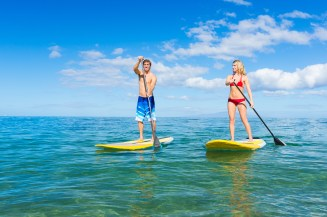 Couple Stand Up Paddle Surfing