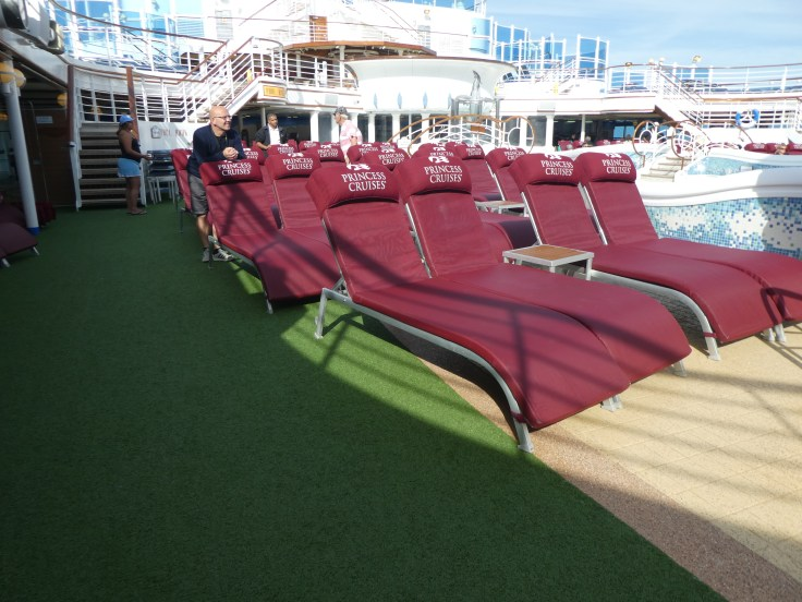 The sun loungers ready for Movies Under the Stars by the main pool