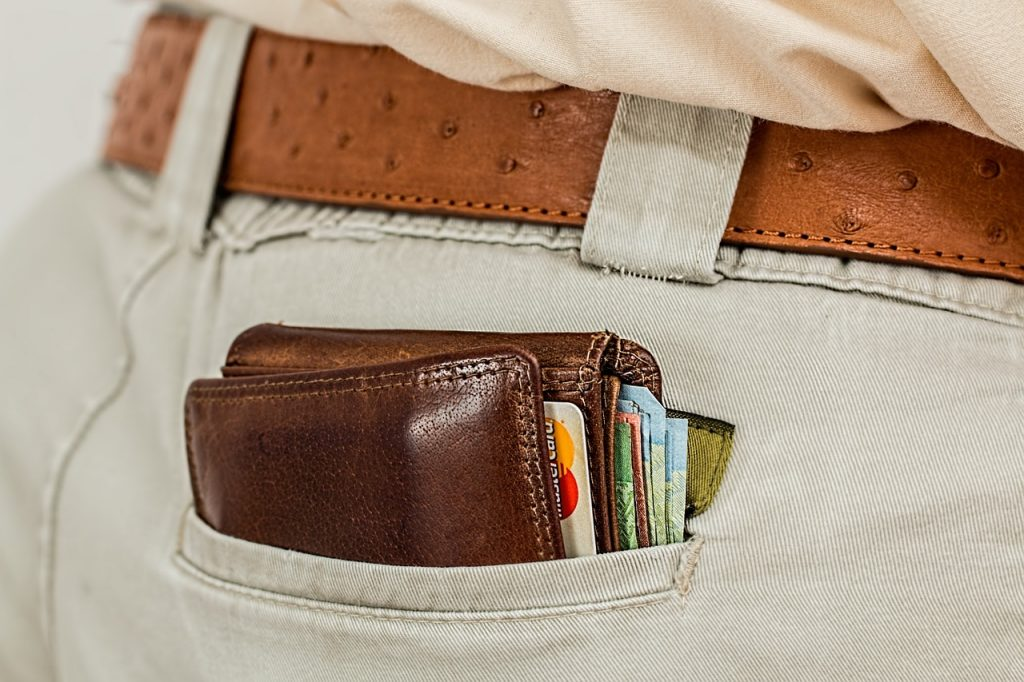 close up of man's back pocket with a full wallet sticking out