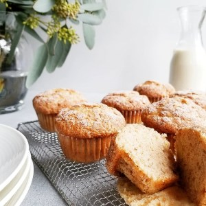 Vegan Snickerdoodle Banana Muffins served with bottle of plant-based milk