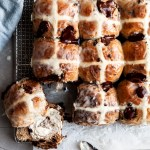 Chocolate Chip Spiced Hot Cross Buns on a plate