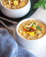 Two bowls of vegan corn and zucchini chowder