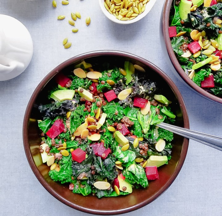 Bowl of Roasted Beet, Kale and Lentil Salad with Golden Dressing, Avocado, Toasted Almonds and Pepitas with Golden Dressing