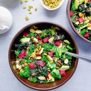 Bowl of Roasted Beet, Kale and Lentil Salad with Golden Dressing, Avocado, Toasted Almonds and Pepitas