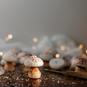 Vegan Meringue Mushroom surrounded by some partly assembled mushrooms