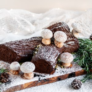 Vegan Chocolate Yule Log decorated with Meringue Mushrooms and candy snow
