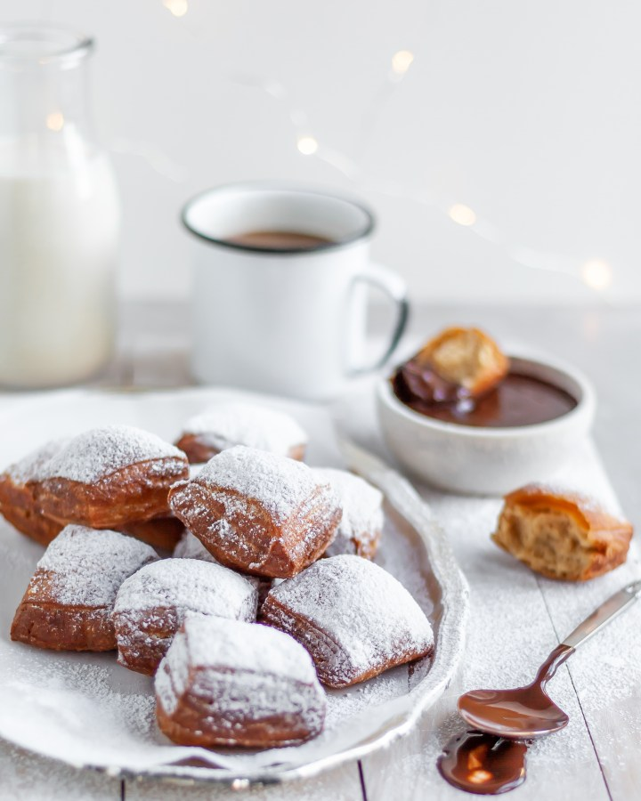 Fresh Vegan Beignets served with powdered sugar, chocolate sauce and coffee