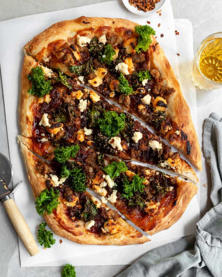 Vegan Caramelized Onion, Sausage and Kale Pizza with Almond Ricotta