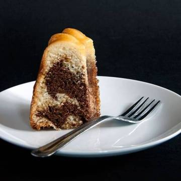 Caramel zebra bundt cake, with swirls of chocolate and vanilla running through it will have you coming back for a more!