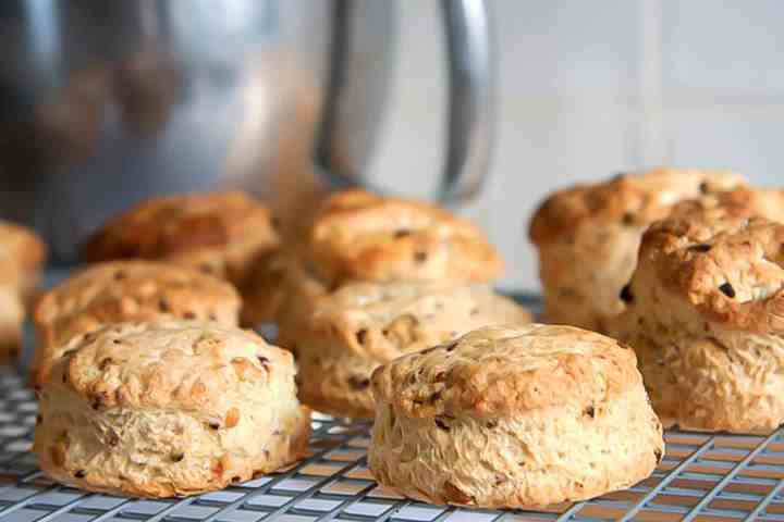 Raspberry and white chocolate scones cooling on a wire rack