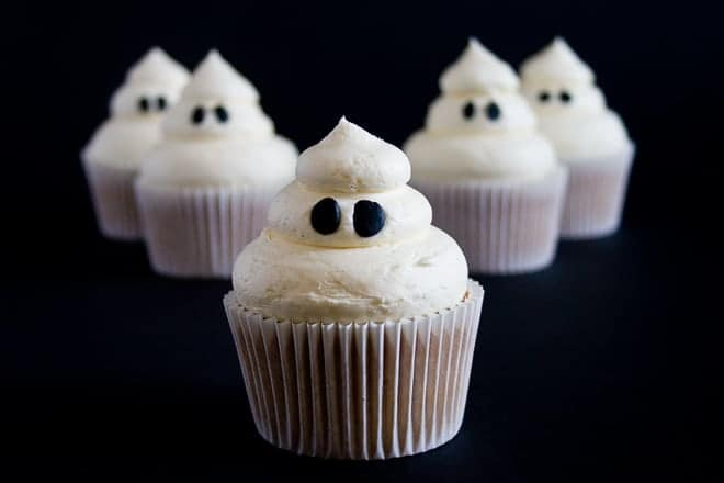 Creepy and kooky Ghosties and Red Devils make Halloween a little cuter and definitely sweeter with these Halloween Sticky Toffee Cupcakes!
