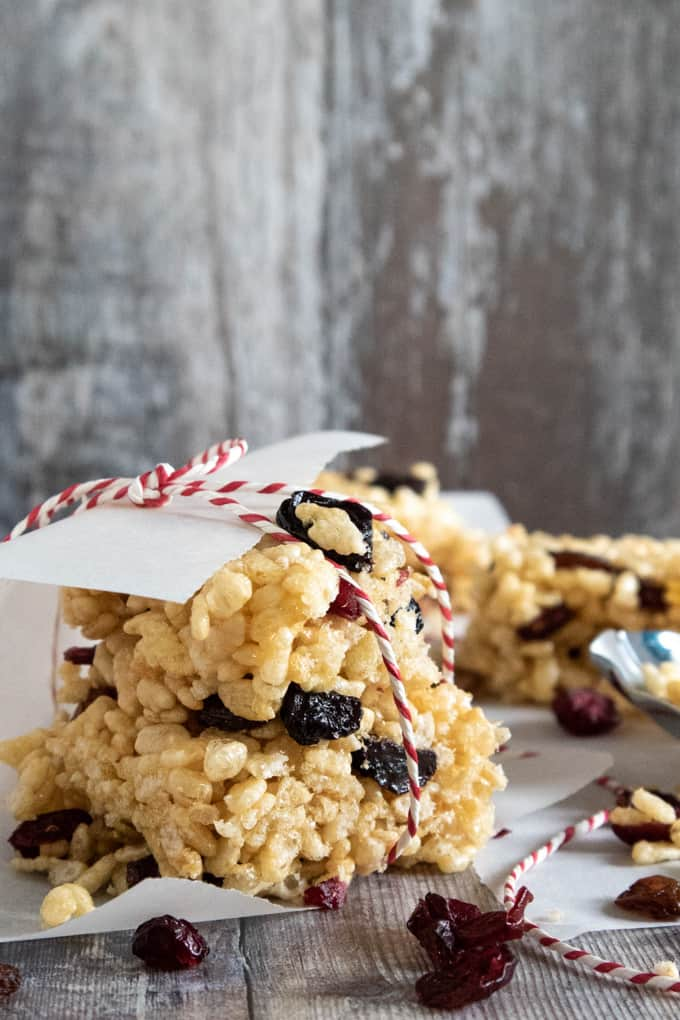 Rice Krispie cereal bar with dried fruit wrapped in baking paper