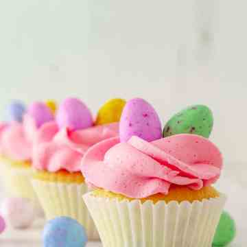 Delight your friends and family for Easter with these cute and delicious mini egg cupcakes. Soft white chocolate cake speckled with coloured candy drops, and topped with a fluffy white chocolate buttercream frosting and the best Easter candy ever... mini eggs.