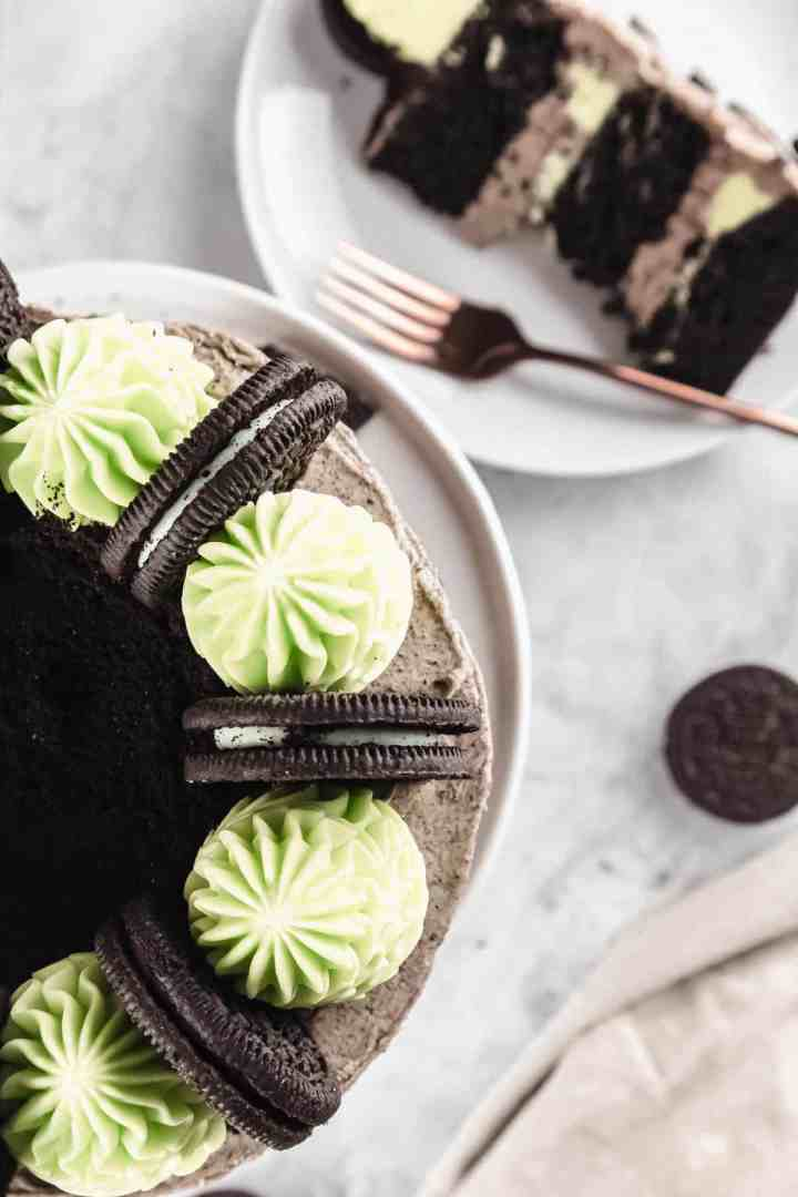 Top view of Mint Oreo cake with green frosting swirls and cookies on top