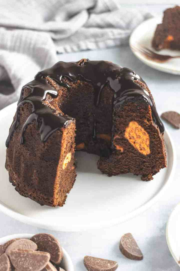 Chocolate orange Bundt cake with a slice cut out to see orange cheesecake filling
