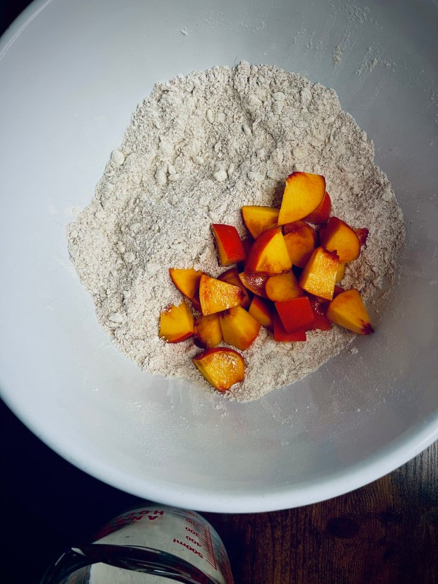 chopped peaches in butter and flour